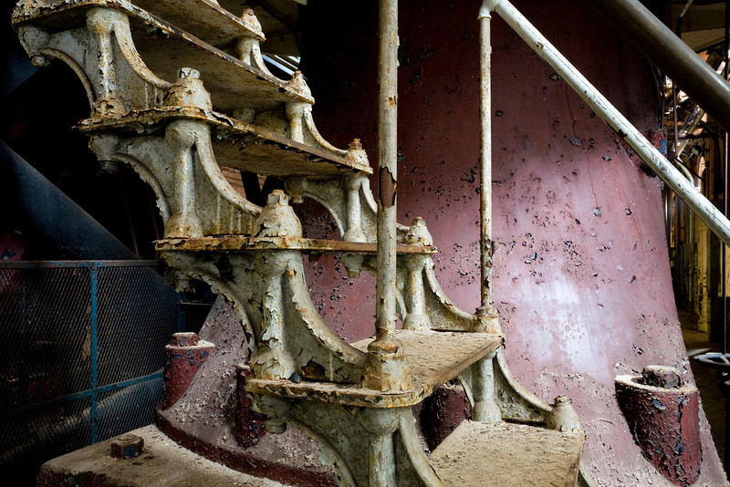 """The iconic cast iron stairs of """"Old #7"""", the well-preserved 1915 5-story VTE pumping engine manufactured by Allis-Chalmers."""