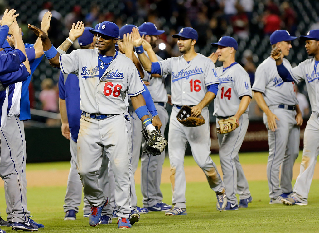 . The Los Angeles Dodgers celebrate their win over the Arizona Diamondbacks after a baseball game, Wednesday, July 10, 2013, in Phoenix. The Dodgers won 7-5 in 14 innings. (AP Photo/Matt York)