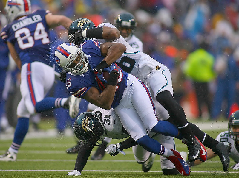 . Brad Smith #16 of the Buffalo Bills is stopped after a gain against the Jacksonville Jaguars at Ralph Wilson Stadium on December 2, 2012 in Orchard Park, New York.  (Photo by Rick Stewart/Getty Images)