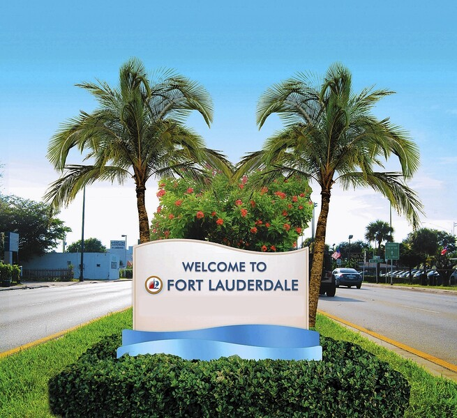 fl-xpm-2014-01-19-fl-tophat-lauderdale-welcome-signs-20140119.jpg