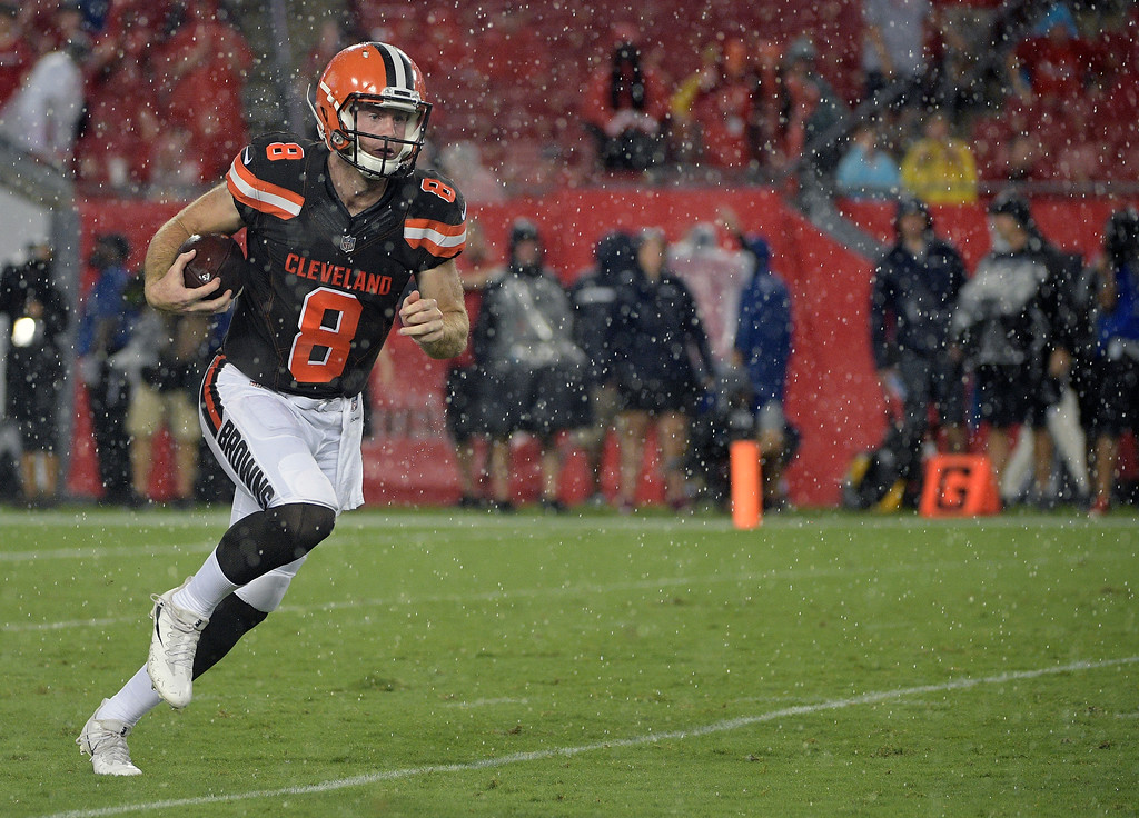 . Cleveland Browns quarterback Kevin Hogan (8) runs against the Tampa Bay Buccaneers during the fourth quarter of an NFL preseason football game Saturday, Aug. 26, 2017, in Tampa, Fla. (AP Photo/Phelan Ebenhack)