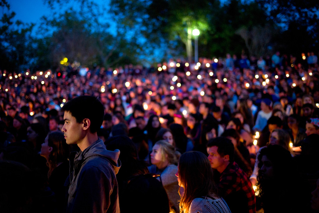 . People gather at a park for a candlelight vigil to honor the victims of Friday night\'s mass shooting on Saturday, May 24, 2014, in Isla Vista, Calif. Sheriff\'s officials say Elliot Rodger, 22, went on a rampage near the University of California, Santa Barbara, stabbing three people to death at his apartment before shooting and killing three more in a crime spree through a nearby neighborhood. (AP Photo/Jae C. Hong)