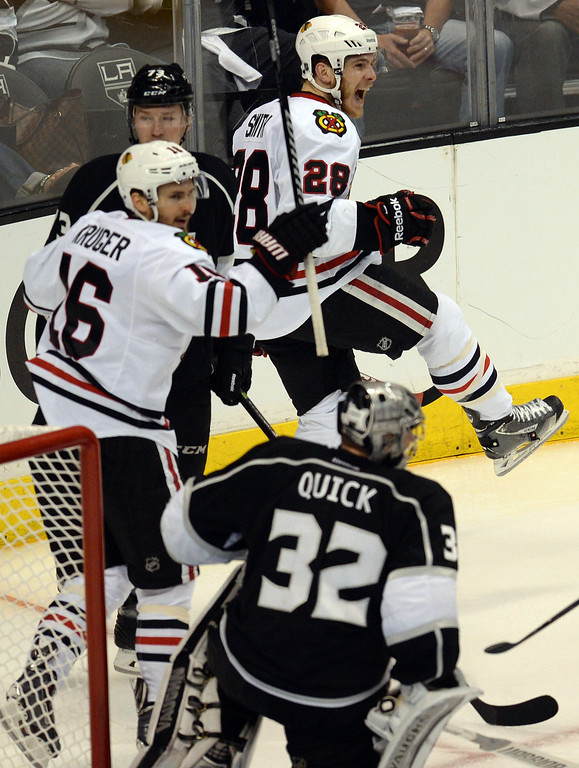 . The Blackhawks� Ben Smith #28 celebrates after bouncing  the puck off of Kings ;goalie Jonathan Quick #32 for a second period gaol during Game 6 of the Western Conference finals at the Staples Center on Friday, May 30, 2014. (Photo by Hans Gutknecht/Los Angeles Daily News)