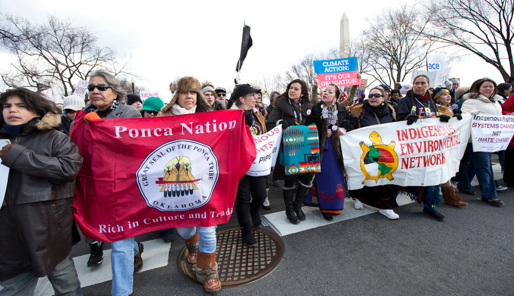. Native Americans including Melina Laboucan, fifth from left, and Crystal Lameman sixth from, from the Cree Nation of Alberta, Canada, march with other protestors from the National Mall to the White House in Washington calling on President Barack Obama to reject the Keystone XL oil pipeline from Canada, as well as act to limit carbon pollution from power plants and ìmove beyondî coal and natural gas, Sunday, Feb. 17, 2013.   (AP Photo/Manuel Balce Ceneta)