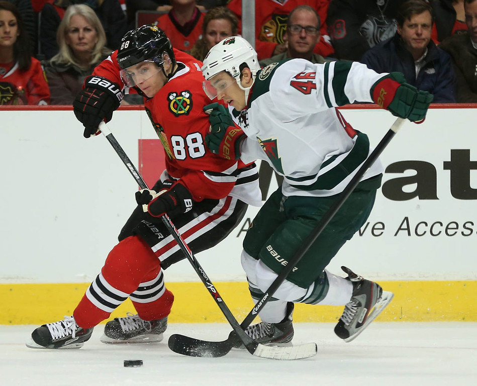 . Chicago Blackhawks right wing Patrick Kane (88) and Minnesota Wild defenseman Jared Spurgeon (46) battle for the puck during the first period. (Chris Sweda/ Chicago Tribune/MCT)