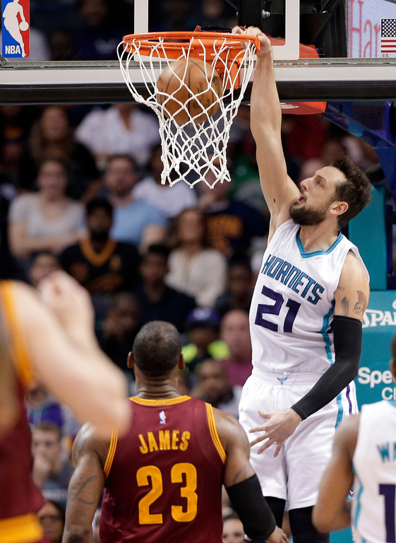 . Charlotte Hornets\' Marco Belinelli (21) dunks in front of Cleveland Cavaliers\' LeBron James (23) during the second half of an NBA basketball game in Charlotte, N.C., Friday, March 24, 2017. The Cavaliers won 112-105. (AP Photo/Chuck Burton)