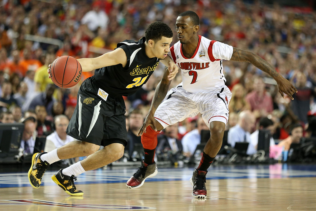 . ATLANTA, GA - APRIL 06:  Fred VanVleet #23 of the Wichita State Shockers drives the ball in the first half against Russ Smith #2 of the Louisville Cardinals during the 2013 NCAA Men\'s Final Four Semifinal at the Georgia Dome on April 6, 2013 in Atlanta, Georgia.  (Photo by Andy Lyons/Getty Images)