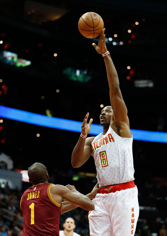 . Atlanta Hawks center Dwight Howard (8) shoots over Cleveland Cavaliers guard James Jones (1) in the first half of a preseason NBA basketball game Monday, Oct. 10, 2016, in Atlanta.  (AP Photo/John Bazemore)