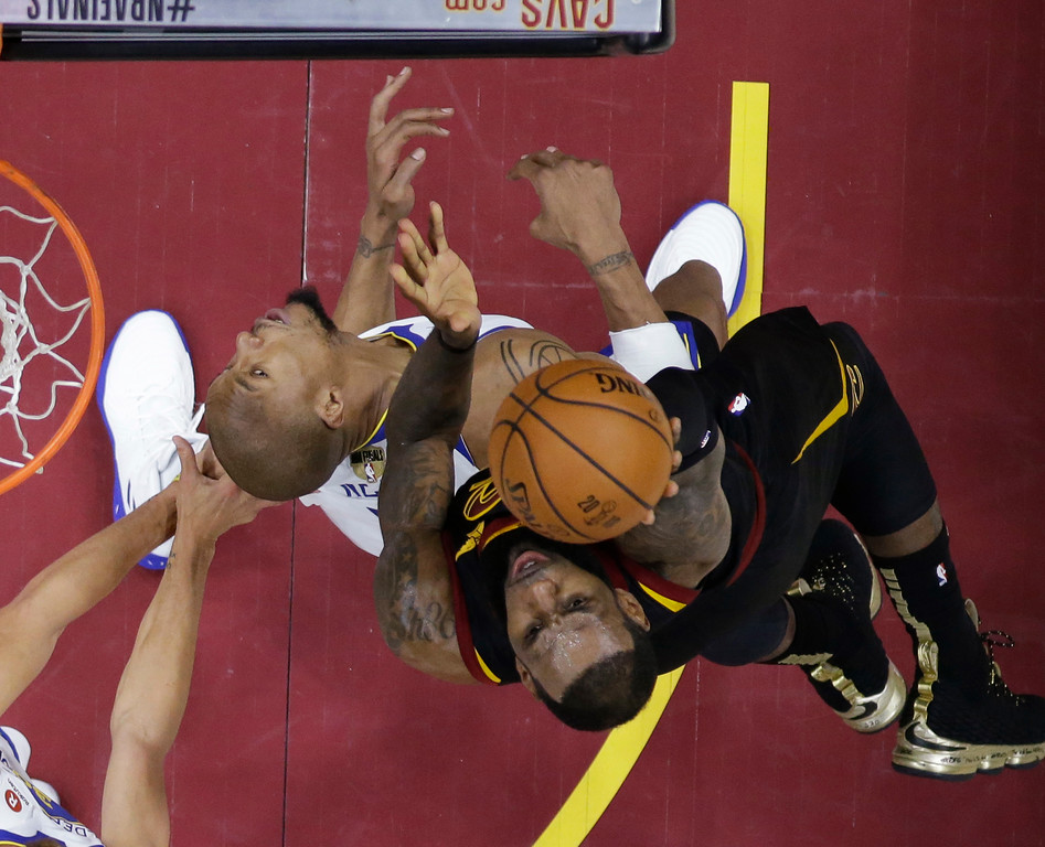 . Cleveland Cavaliers\' LeBron James shoots over Golden State Warriors forward David West during the first half of Game 4 of basketball\'s NBA Finals, Friday, June 8, 2018, in Cleveland. (AP Photo/Carlos Osorio, Pool)