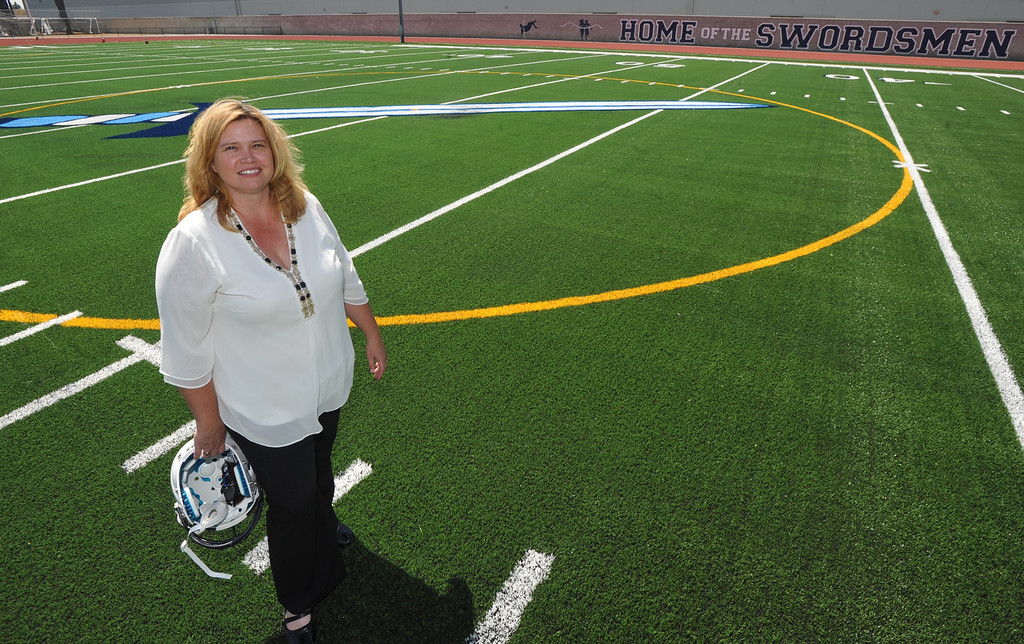 . Principal Kate Aceves stands on their newly completed Astroturf football field at St. Paul High School in Santa Fe Springs on Friday August 9, 2013. St. Paul officials, students, and alumnae will dedicate the school\'s new football field and volleyball and basketball floors on Saturday.