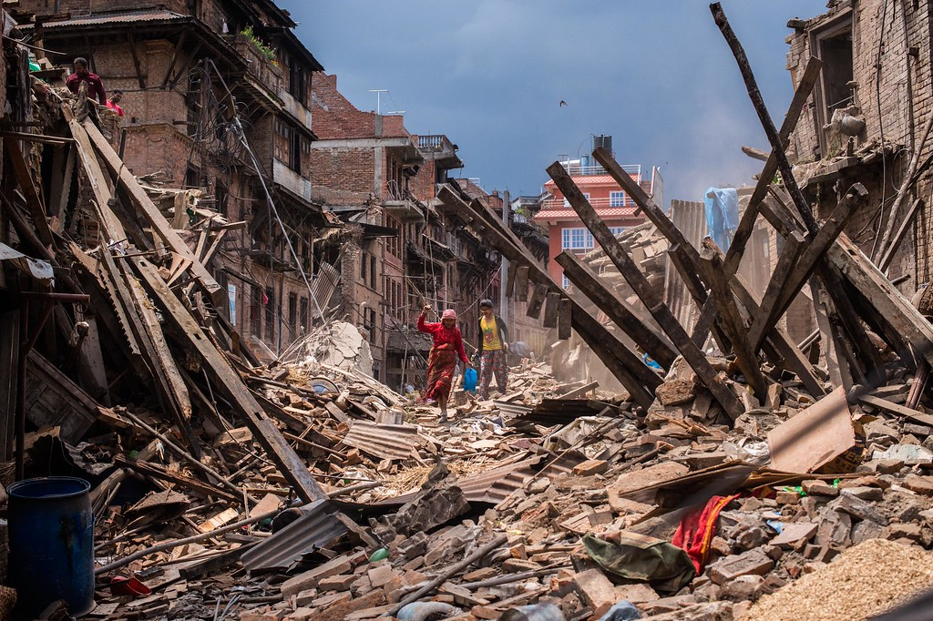 . Nepalese victims of the earthquake search for their belongings among debris of their homes on April 29, 2015 in Bhaktapur, Nepal. A major 7.8 earthquake hit Kathmandu mid-day on Saturday, and was followed by multiple aftershocks that triggered avalanches on Mt. Everest that buried mountain climbers in their base camps. Many houses, buildings and temples in the capital were destroyed during the earthquake, leaving over 4600 dead and many more trapped under the debris as emergency rescue workers attempt to clear debris and find survivors. Regular aftershocks have hampered recovery missions as locals, officials and aid workers attempt to recover bodies from the rubble.  (Photo by David Ramos/Getty Images)