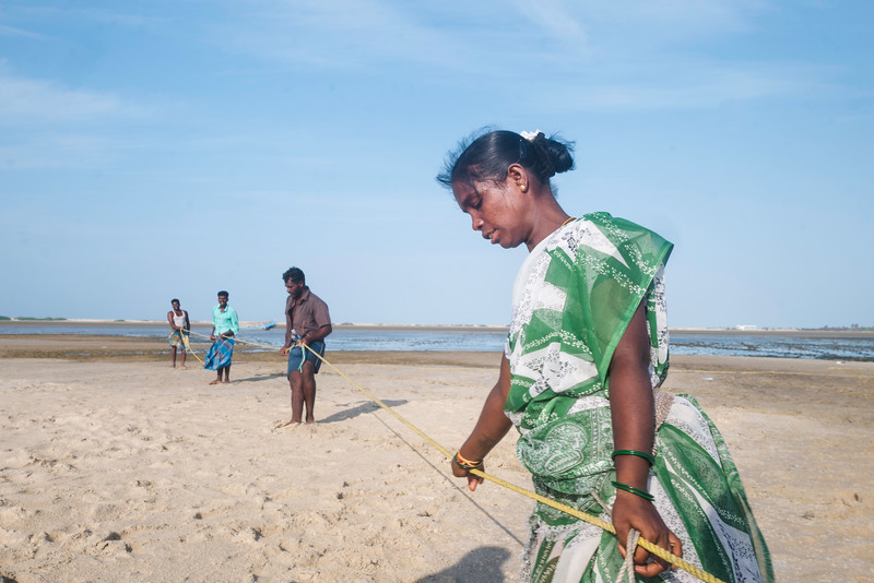 Amudha started to work in place of her mother when she wasn't strong enough for the job. She earns daily wages of 50-100 rupees by pulling the fishing net from the sea, at times the net could be as heavy as one ton or more.