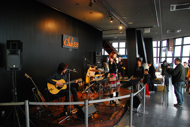 The band plays at Club 333 (meters) atop Tokyo Tower