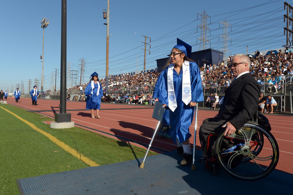 . Amanda Canal walks to receive her diploma from Mark Steffen. The 2013 North High School commencement ceremonies take place on the school\'s football field in Torrance Wednesday afternoon.