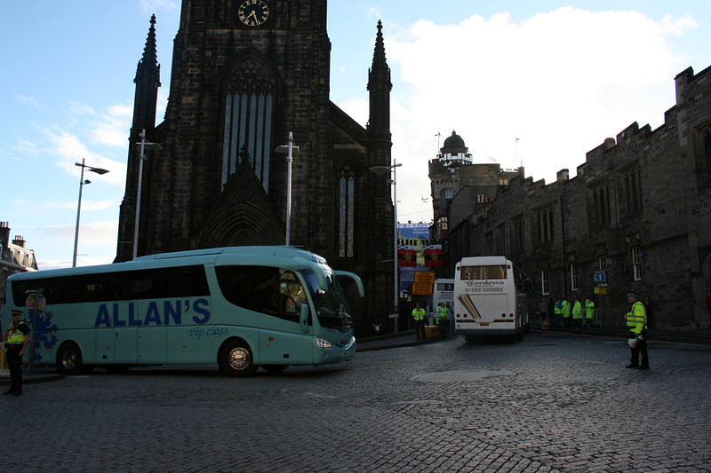 scores of performers arriving for the Edinburgh Military Tattoo.