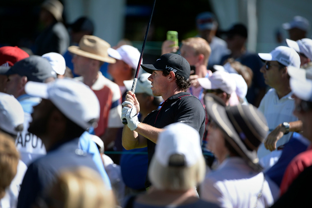 . CHERRY HILLS VILLAGE, CO. - SEPTEMBER 03:  Pro golfer, Rory McIIroy, eyes his tee shot on the 5th tee box, surrounded by spectators during the FedExCup BMW Championship Pro-Am at the Cherry Hills Country Club Wednesday, September 03, 2014. (Photo By Andy Cross / The Denver Post)