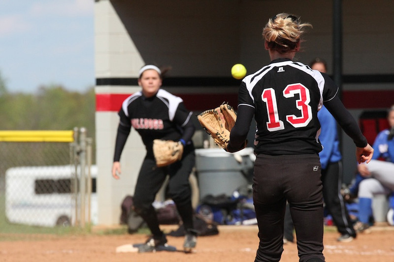 Number 13, Jordyn Arrowood, throwing to first to get the runner out.