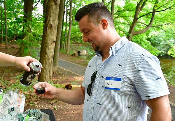 7/27/2019 Mike Orazzi | Staff Steve Cios samples beer from Firefly Hollow Brewing during the Hungerford Nature Center's Beer in the Woods event Saturday evening.
