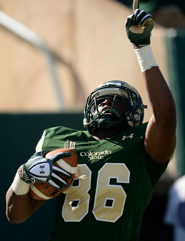 . FORT COLLINS, CO - OCTOBER 12 : Kivon Cartwright of Colorado State (86) celebrates his 2nd quarter touchdown in the game against San Jose State at Hughes Stadium. Fort Collins. Colorado. October 12, 2013. San Jose won 34-27. (Photo by Hyoung Chang/The Denver Post)