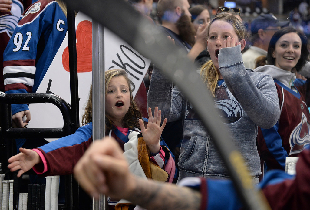 . Avalanche fans cheered as the players walked by on the way to the locker room Saturday night. The Colorado Avalanche hosted the Minnesota Wild at the Pepsi Center Saturday night, April 19, 2014 in an NHL playoff game. (Photo by Karl Gehring/The Denver Post)