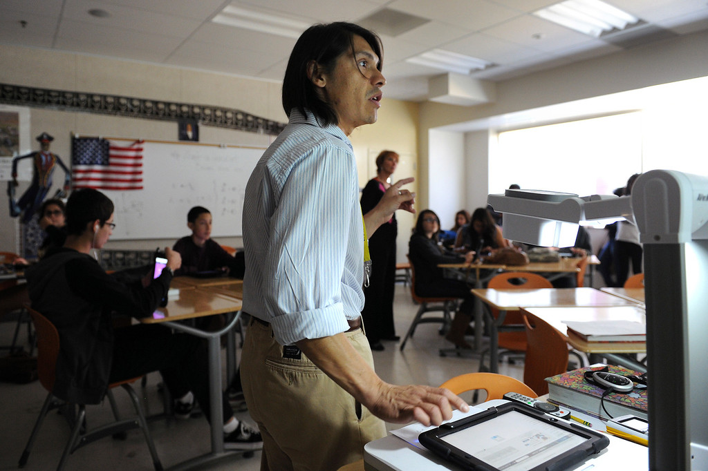 . Valley Academy of Arts & Sciences math teacher Francis Cañas gives a lesson using an iPad, Tuesday, October 15, 2013. The Valley Academy is one of two LAUSD schools in the San Fernando Valley that are participating in the rollout of the iPad plan. (Photo by Michael Owen Baker/L.A. Daily News)