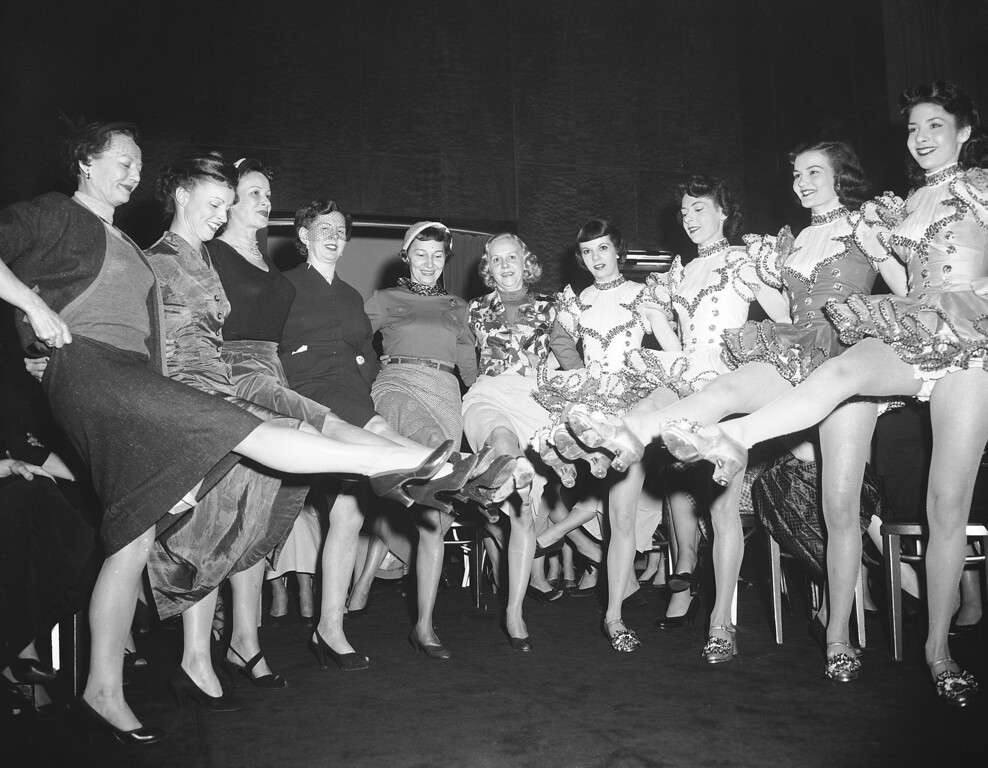 . Six former Rockettes, left, match kicks with four present members of the famed chorus line in New York\'s Radio City Music Hall, Jan. 20, 1955.  Ex-Rockettes from left, with surnames available only, are: Sabin of Framingham, Mass., Benzenberger of New Milford, Pa., MacPherson of Alexandria, Va., Walsh of Skaneateles, N.Y., Warren of Philadelphia, Pa., and Dawley of Brown Mills, N.J.  Current members are Carol Sickel of Irvington, N.J., Marion Block of Columbus, Ohio, Eleanor Dunne of Wayne, Pa., and Jean Browning of New York.  (AP Photo)