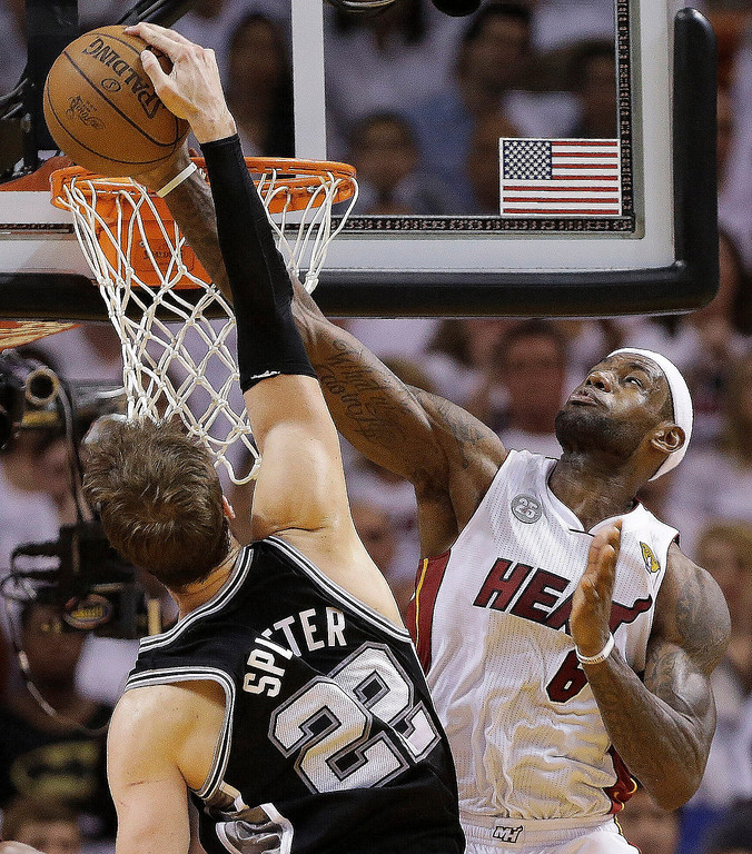 . Miami Heat small forward LeBron James (6) blocks a shot by San Antonio Spurs center Tiago Splitter (22) of Brazil, during the second half of Game 2 of the NBA Finals basketball game, Sunday, June 9, 2013 in Miami. The Miami Heat won 103-84. (AP Photo/Lynne Sladky)