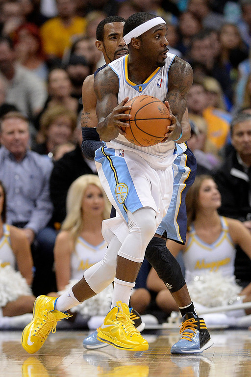 . Memphis Grizzlies guard Mike Conley (11) defends Denver Nuggets guard Ty Lawson (3)  during the second quarter. (Photo by AAron Ontiveroz/The Denver Post)