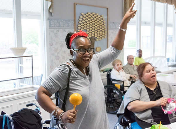 05/15/18 Wesley Bunnell | Staff Singer Kate Stone entertained the residents of Autumn Lake Healthcare in New Britain during Happy Hour on Wednesday May 15th. Shantel Brown dances with maracas as friend Luz Rivera plays the tamborine.