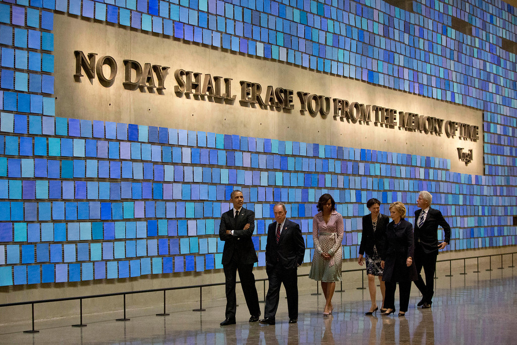 . President Barack Obama, first lady Michelle Obama, former New York City Mayor Michael Bloomberg, former Secretary of State Hillary Rodham Clinton, former President Bill Clinton, and Diana Taylor, tour the Memorial Hall at the National September 11 Memorial Museum, Thursday, May 15, 2014, in New York.  (AP Photo/Carolyn Kaster)