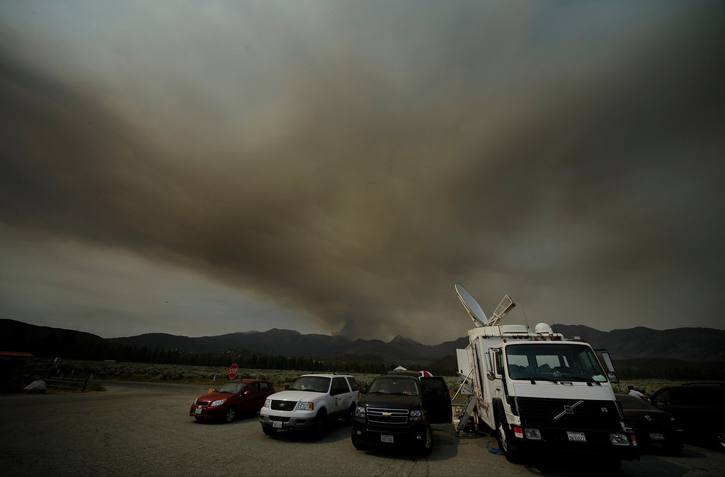 . during the Mountain Fire near Idyllwild, California July 18, 2013. The blaze erupted on Monday afternoon about 100 miles (161 km) east of Los Angeles in the scenic but rugged San Jacinto Mountains that overlook Palm Springs, Rancho Mirage and several smaller desert towns.  Photo by Gene Blevins/LA Dailynews