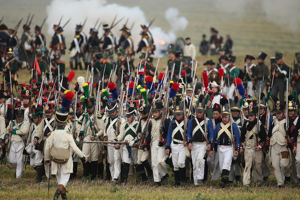 . Historical society enthusiasts in the role of French infantry troops fighting for Napoleon retreat during the re-enactment of The Battle of Nations on its 200th anniversary on October 20, 2013 near Leipzig, Germany.  (Photo by Sean Gallup/Getty Images)