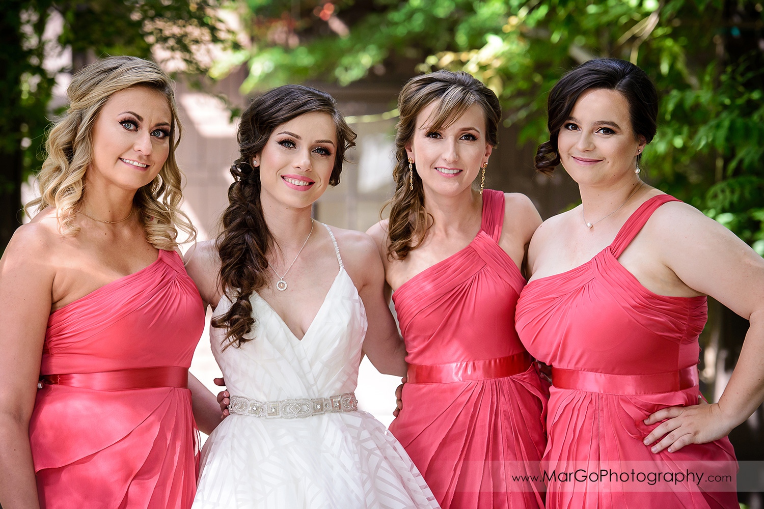 portrait of bride and bridesmaids in pink dresses at Saratoga Foothill Club