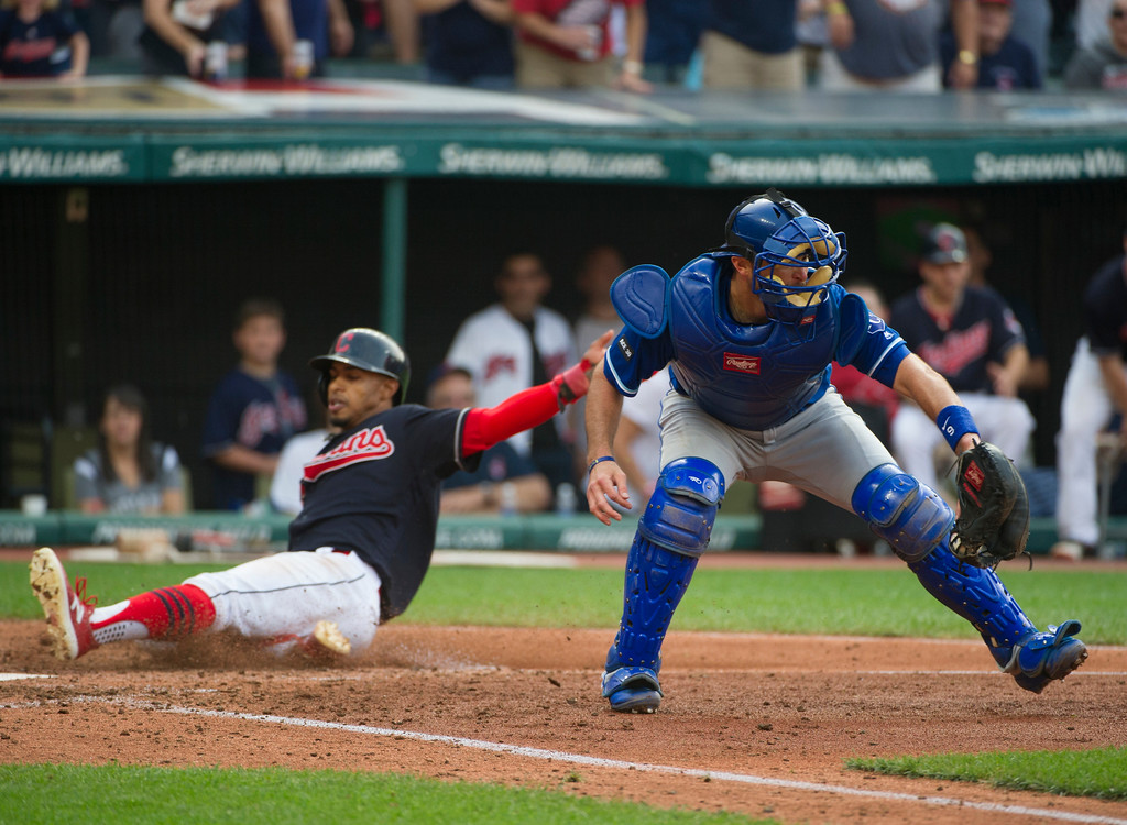 . Kansas City Royals\' Drew Butera catches the throw to home as Cleveland Indians\' Francisco Lindor scores, during a baseball game in Cleveland, Saturday, Sept. 16, 2017. (AP Photo/Phil Long)