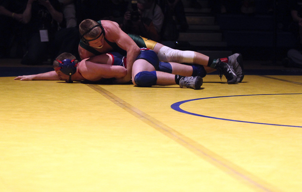 . Livermore\'s Tyler Rardon, top, wrestles Rancho Cotate\'s Joey Clay in the 152-pound finals at the North Coast Section wrestling championships held at Newark Memorial High School in Newark, Calif., on Saturday, Feb. 23, 2013. Rardon would get the win. (Anda Chu/Staff)