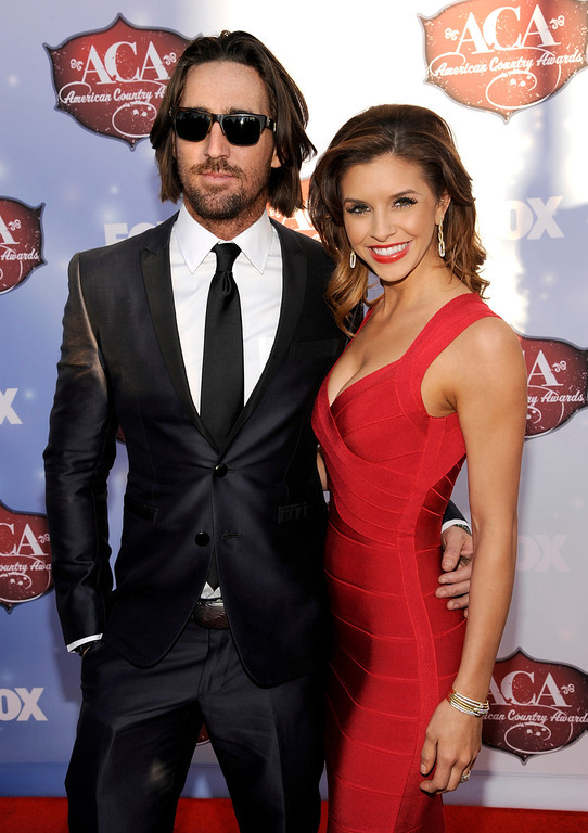 . Jake Owen, left, and Lacey Buchanan arrive at the American Country Awards at the Mandalay Bay Resort & Casino on Tuesday, Dec. 10, 2013, in Las Vegas, Nev. (Photo by Chris Pizzello/Invision/AP)