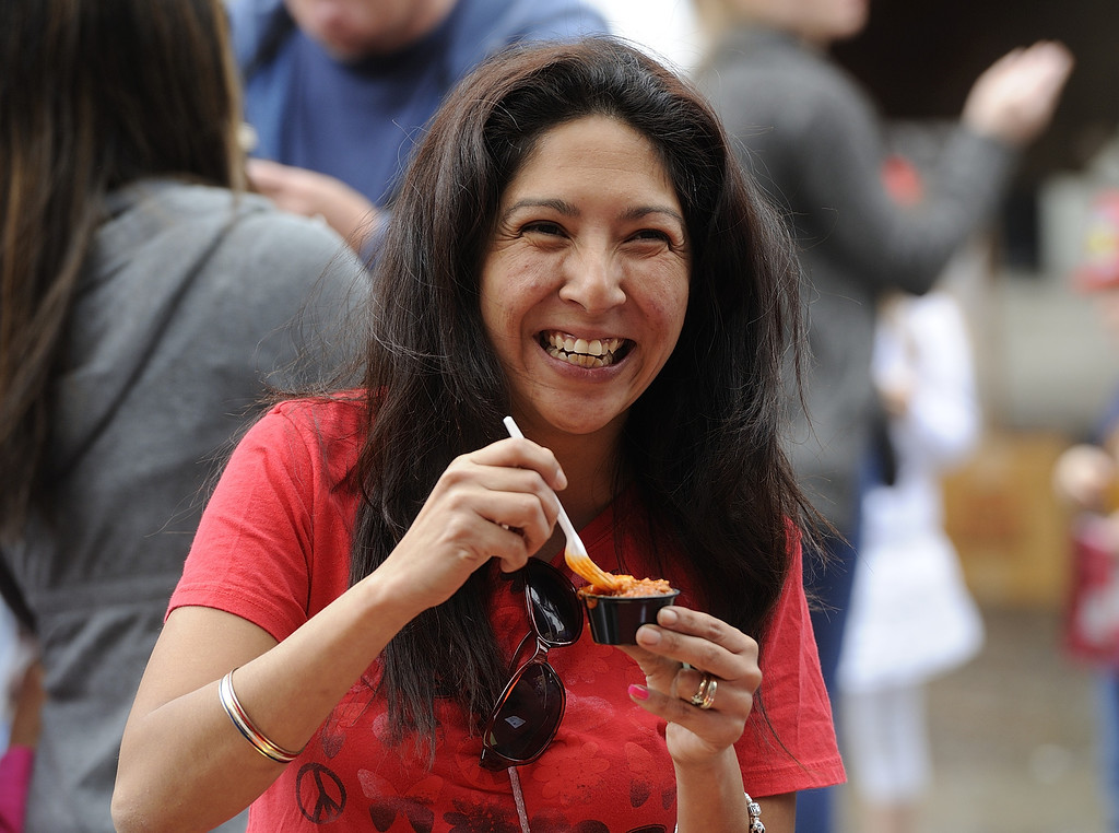 . TORRANCE, CALIF. USA -- Lilly  Claxton take in some chili in Torrance, Calif., on April 14, 2013. The Old Torrance Festival Day is a charity fundraiser that will benefits the South Bay Police and Fire Memorial Foundation and the Torrance Relay for Life. Photo by Jeff Gritchen / Los Angeles Newspaper Group