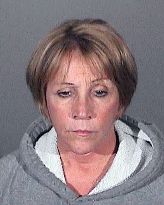 . Mary Louise Wasilchin, 58, of Upland was arrested Thursday and booked on suspicion of misappropriating $342,000 of city funds and hiding a police report while she worked as the Covina police records