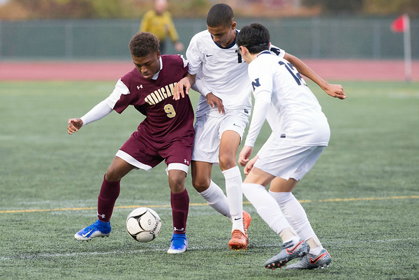 10/29/19 Wesley Bunnell | StaffrrNew Britain soccer was defeated 2-0 by Newington during a drizzle at Veterans Stadium on Tuesday afternoon. New Britain's Shevon Traille (9), Newington's Youseff Khadrani (17) and Tyler Ferreira (12).