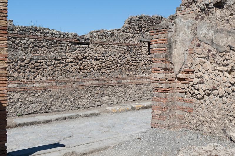 Stone and brick walls at Pompeii, Italy