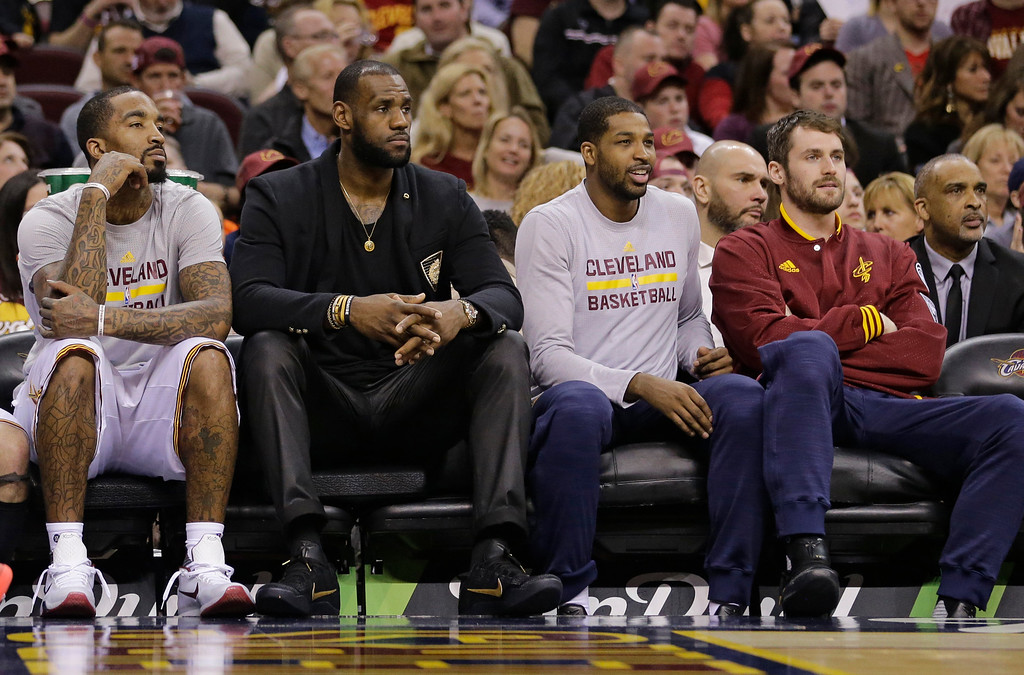. Cleveland Cavaliers\' J.R. Smith, LeBron James, Tristan Thompson and Kevin Love, from left, watch from the bench during the first half of the team\'s NBA basketball game against the Detroit Pistons, Wednesday, April 13, 2016, in Cleveland. (AP Photo/Tony Dejak)