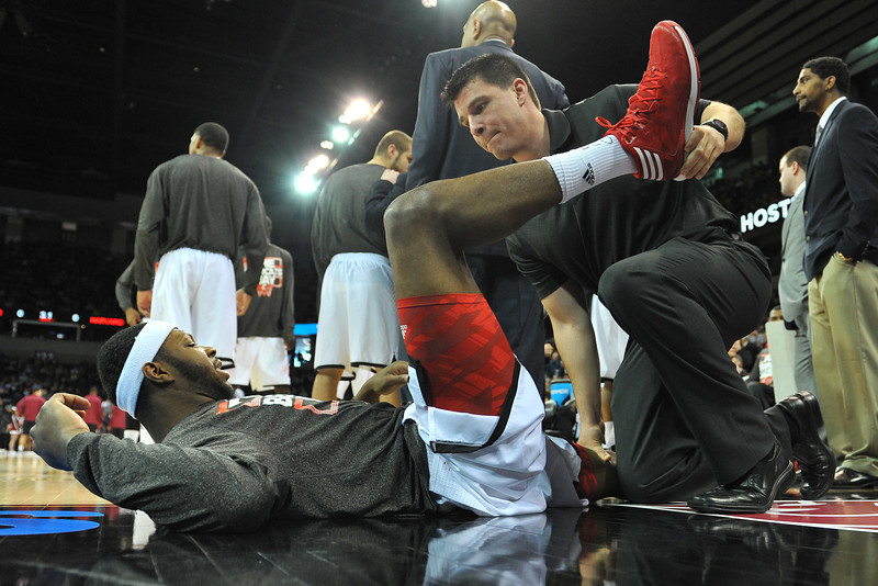 March 20, 2014: A Cincinnati Bearcats player gets stretched before a second round game of the NCAA Division I Men's Basketball Championship between the 5-seed Cincinnati Bearcats and the 12-seed Harvard Crimson at Spokane Arena in Spokane, Wash. Harvard defeated Cincinnati 61-57.