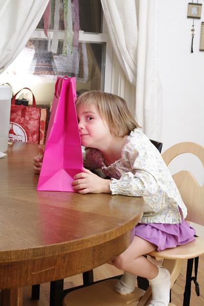 Anya likes the gift bag Paul chose.