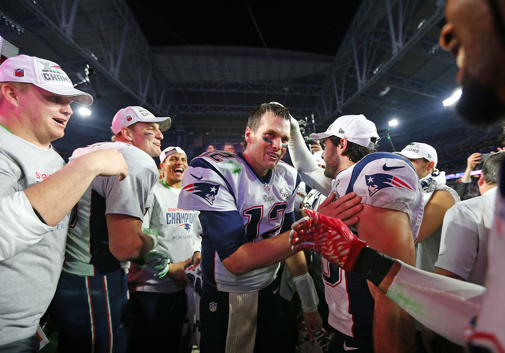 . GLENDALE, AZ - FEBRUARY 01:  Tom Brady #12 of the New England Patriots celebrates after defeating the Seattle Seahawks 28-24 to win Super Bowl XLIX at University of Phoenix Stadium on February 1, 2015 in Glendale, Arizona.  (Photo by Elsa/Getty Images)