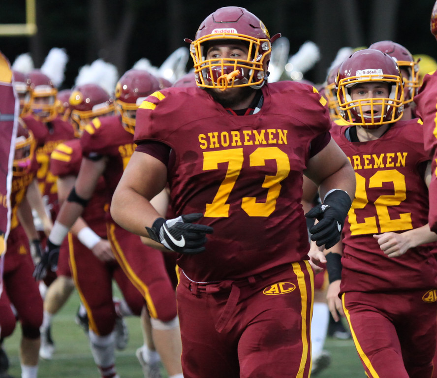 . Randy Meyers - The Morning Journal<br> Avon Lake senior Ryan Beckman leads the Shoremen onto the field against Avon on Sept. 7.