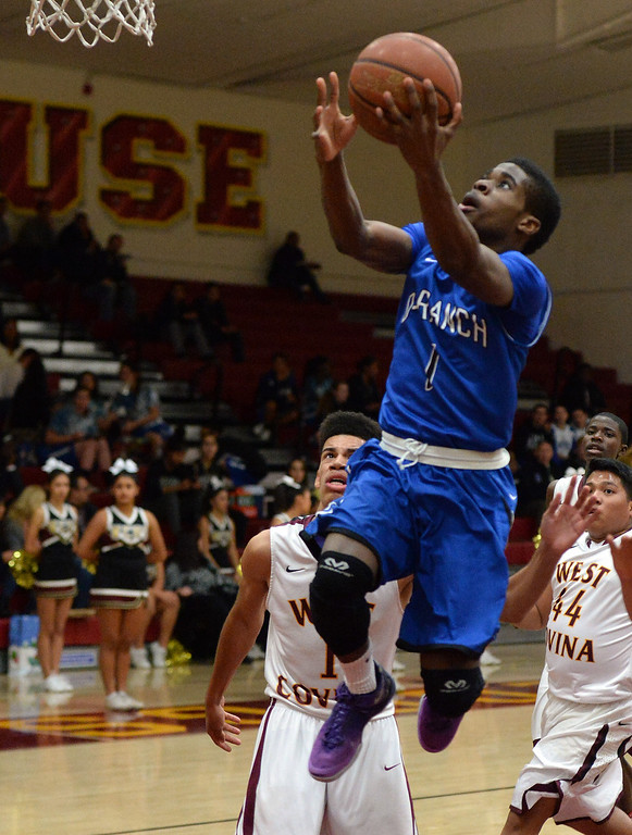. Diamond Ranch\'s Ernest Ugoagu (1) drives to the basket against West Covina in the first half of a prep basketball game at West Covina High School in West Covina, Calif., on Wednesday, Jan. 8, 2014. (Keith Birmingham Pasadena Star-News)