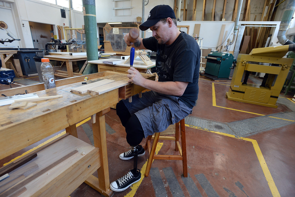 . Noah Bailey cuts dovetail joints in maple drawer sides as he works on a piece in Pleasant Hill, Calif. on Wednesday, July 24, 2013. The Diablo Woodworkers are reaching out to military veterans like Bailey and emphasizing the therapeutic qualities of woodworking. (Kristopher Skinner/Bay Area News Group)