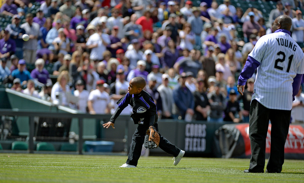 . DENVER, CO. - APRIL 21: Colorado Rockies retired player Eric Young stands with his son Dallas Young 6-years-old as he throws out the first pitch to his older brother Eric Young Jr. prior to their game against the Arizona DiamondBacks April 21, 2013 at Coors Field. (Photo By John Leyba/The Denver Post)