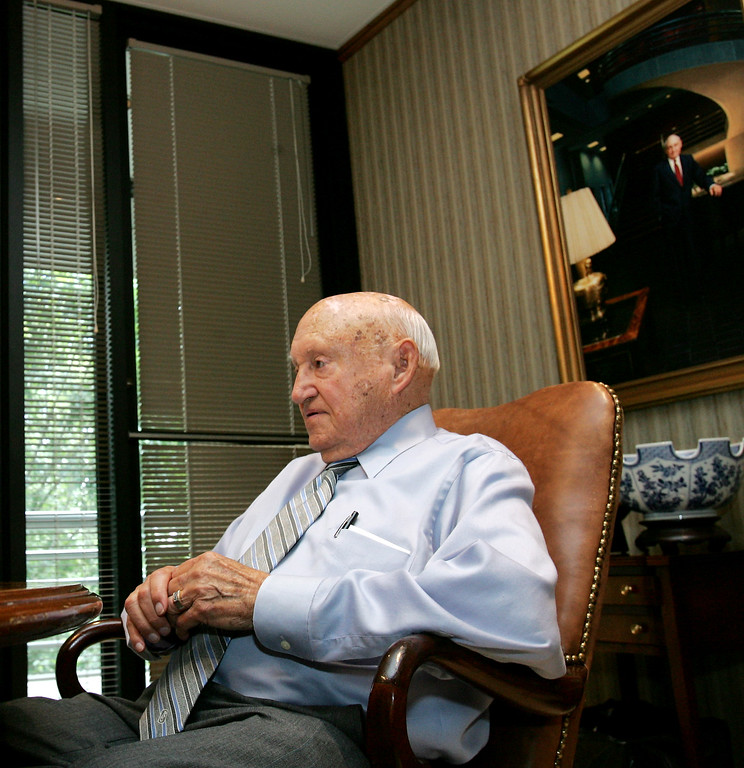 . Chick-fil-A founder Truett Cathy listens during an interview at his corporate headquarters office in Hapeville, Ga., Wednesday, July 26, 2006.  The fast-food chain\'s restaurants close on Sundays to give employees a day of rest, a business decision 85-year-old Cathy said has been a big factor in the company\'s success, by sticking to his doctrine of considering people before profits. (AP Photo/Ric Feld)