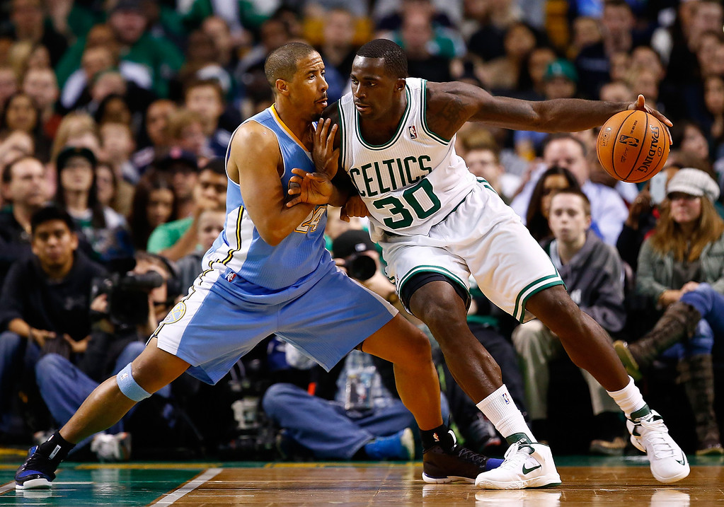 . BOSTON, MA - DECEMBER 06: Brandon Bass #30 of the Boston Celtics is defended by Andre Miller #24 of the Denver Nuggets in the second half during the game at TD Garden on December 6, 2013 in Boston, Massachusetts.  (Photo by Jared Wickerham/Getty Images)